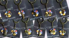 Wholesale starter pack of 48 Bronze tone solid metal keyrings. Assorted novelty designs. Animals, transport, souvenirs, etc. Wedding favours, corporate gifts, fundraising, newsagents by KeyParcels, http://www.amazon.co.uk/dp/B00KGDIFSU/ref=cm_sw_r_pi_dp_4kdMtb04FXVBS
