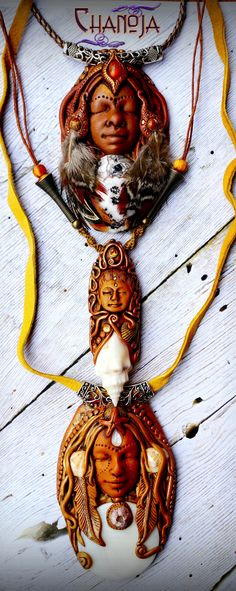 Three Goddesses-by ChaNoJaJewelry. The Kuan Yin pendant features a beautiful seashell and lots of magical sparkly golden swirls.  The Medicine Woman is truly an eye catcher! I used a wonderful flashy mexican fire opal in her forehead and a gorgeous lace agate with a landscape pattern.  The Sea Goddess pendant features a large polished shell coin as the focal bead. Real shells found at spanish beaches make this piece unique.