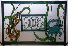 Stained Glass Window Panel / Transom with House Number / Crab and Anchor (AM-2). $385.00, via Etsy.