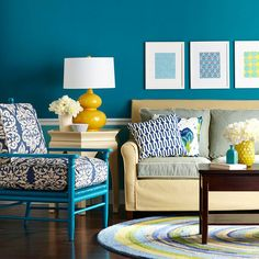 Teal walls make the perfect backdrop for a collection of bright colors. More decorating with blue: http://www.bhg.com/decorating/color/paint/blue-home-decorating-ideas/?socsrc=bhgpin092913tealwallspage=3