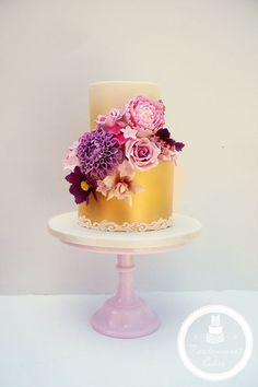 Elegant/Modern two-tiered wedding cake with a sugar flower bouquet