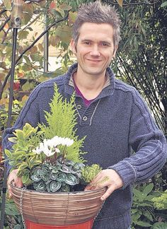 Wicker man: Martyn Cox with his winter hanging basket