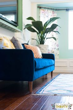 Blush, Navy, Yellow Master Bedroom reveal. Check out the beautiful navy blue couch and plant.