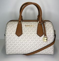Save big on the Michael Kors Hayes Large Duffle Signature Mk Vanilla/Acorn Leather Satchel! This satchel is a top 10 member favorite on Tradesy. See how much you can save. Michael Kors Satchel, Handbags Michael Kors, Louis Vuitton 2017, Balenciaga Handbags, Handbag Stores, Purses And Bags, Women's Bags, Luxury Bags, Large Bags