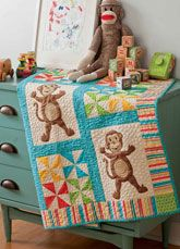 Monkey Madness Digital Pattern from ShopFonsandPorter.com -  Love of Quilting January February 2013 issue. Three little monkeys, jumping on the bed…Along with pinwheel blocks and a stripe border, the monkeys complete this adorable quilt-sized perfectly for a toddler. Quilt designed by DeElda Wittmack