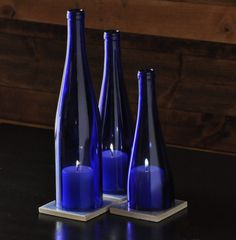 Set of Blue Wine Bottle hurricane lamps, Wedding Centerpiece, Table Centerpiece, wine bottle candles.  Comes with three tile coasters with crushed crystal inlay.