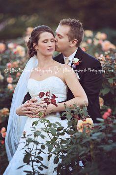 Matt and Devons Kansas City Wedding by Jillian Farnsworth Photography.  Photo taken at a rose garden in Loose Park. #kansascity #wedding #loosepark #rings #jillianfarnsworthphotography #dress