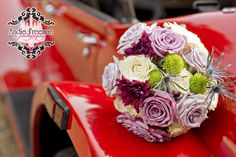 Bridal bouquet with sterling roses and white hydrangeas on vintage red sports car. Country fall wedding at hunting lodge.  Photography:  Andie Freeman Photography www.TheAthensWeddingPhotographer.com Coordinating, floral, and event design:  Wild Flower Event Services Venue:  Fair Weather Farms, Monroe, GA Catering:  Master's Table www.cateringbythemasterstable.com