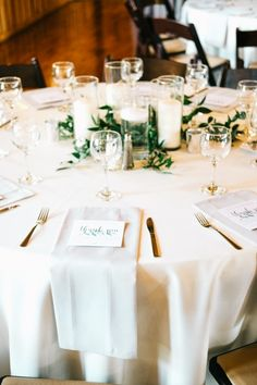 Timeless + evergreen wedding decor. SO gorgeous with the greenery and white candles!