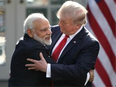 """The Indian Prime Minister has escaped the infamously tense and awkward handshakes between Donald Trump and other world leaders by going in for a bear hug more than once.  Narendra Modi met with the US President at the White House for the first time and avoided the """"yanking"""" handshake of Mr"""