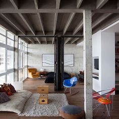 I enjoy the industrial designed space with the shag carpet making it a cozy space