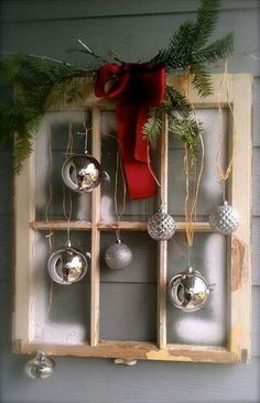 Repurpose old window - Christmas window idea with window pane, red bow, silver ornaments. Juniper for the greenery, and a red print ribbon for the bow! Nice idea.