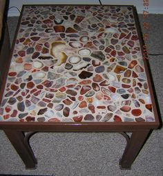 Made table and top myself. Sliced and polished stones set in grout, then resin poured on top.