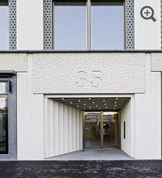 Separate doors for the two residential elements are each housed in a deep recess of pharaonic monumentality  MIXED DEVELOPMENT IN ZURICH BY CARUSO ST JOHN ARCHITECTS AND BOSSHARD VAQUER ARCHITEKTEN