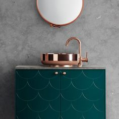 copper bathroom faucet and fish scale cabinet