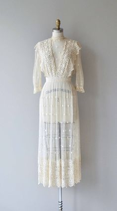 Antique 1910s Edwardian silk embroidered net lace dress, sheer with gorgeous embroidery, 3/4 sleeves, fitted waist and hook and eye clasp closures. --- M E A S U R E M E N T S --- fits like: xs bust: 32-34 waist: 24 hip: free length: 52 brand/maker: n/a condition: excellent to ensure a good fit, please read the sizing guide: http://www.etsy.com/shop/DearGolden/policy ✩ layaway is available for this item ✩ more vintage dresses ✩ http://www....