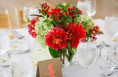 {{Wedding centerpiece with red dahlias, green hydrangea, and butterfly weed. Summer wedding with locally grown flowers.}} Flowers by Pollen, pollenfloraldesign.com || photos by Greenhouse Loft, || greenhouseloft.com