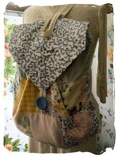 Another pinner said...Here's what to do with fabric scraps vintage doilies & buttons.. make a backpack as I did .. easy to do and very useful too!