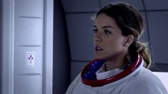 """Raegen (Melanie Merkosky) suits up to investigate a drifting space craft in the 2012 web series """"Continuum"""""""