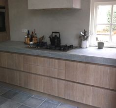 natural-living-concrete counter? notice hood