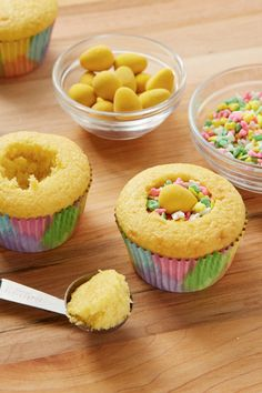 Scoop out the middle of cupcakes with a melon baller, fill with sweet surprises and cover with frosting!