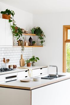 Cantilever-Interiors-kitchen-bench-tops-open-shelving