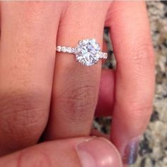 Diamond solitaire engagement ring with a diamond shank. #diamondsolitairering #DazzlingDiamondEngagementRings
