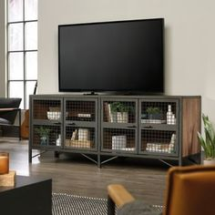 The Boulevard Cafe Metal and Oak Finish Credenza by Sauder Woodworking Co. is the perfect place for a TV and has an undeniable sleek transitional charm that accents any living room! This credenza is made with charcoal gray colored metal and manufactur Industrial Tv Stand, Industrial Style, Industrial Office, Café Mobile, Farmhouse Tv Stand, Living Spaces, Living Room, Entertainment Stand, Coffee Table With Storage