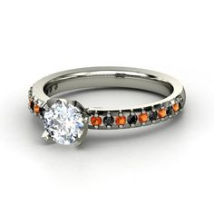 Diamond with fire opals and black diamonds in band