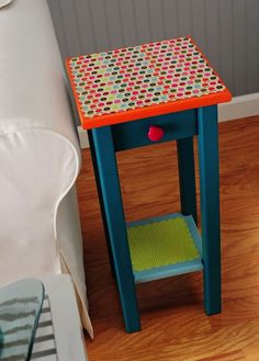 This is one of my favorite projects ever! You can upcycle an endtable with basic acrylic paint, paper and Mod Podge. If bright colors aren't your thing, customi…