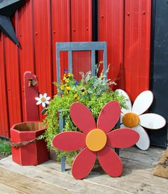Chippy old paint planter chair and wooden daisies