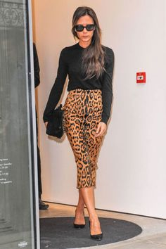 Victoria Beckham's recipe for glamour: a body-skimming pencil skirt that hits just below the knee.