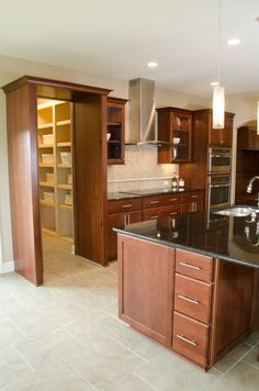 2014 Integrity Parade of Homes House - hidden pantry feature Hidden Pantry, Residential Construction, Kitchen Dining, Dining Rooms, Parade Of Homes, Beautiful Homes, Integrity, Kitchens, House