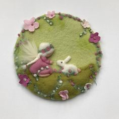Spring Picture with a fairy,bunny and many felted flowers. This tapestry is wet felted and Needle Felted. Average Diameter:12,5 inches. Your purchase will be sent within 5/10 business days. If you need something to be shipped faster, please contact us. We ship from Germany to keep the