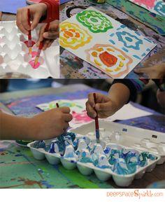 "Children exploring colour, using the book ""Pantone Colors,"" for inspiration."