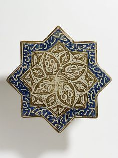 Tile      Place of origin:      Iran (made)     Date:      12th century-13th century (made)     Artist/Maker:      unknown (production)     Materials and Techniques:      Fritware, painted with lustre over the glaze     Museum number:      403-1905