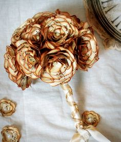Small bridesmaids bouquet or throwing bouquet made with vintage music paper and pearl accents. $35.00, via Etsy.