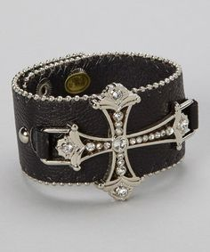 Bedecked in shimmering rhinestones, this adjustable leather bracelet makes for an edgy yet chic choice.