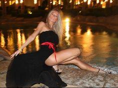 Blonde girl in black dress