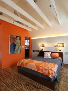 Soothing colors, great pillow. A mix of cream and funky orange (Benjamin Moore Calypso)