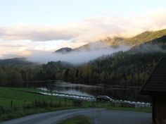 View of the #fog and the #sunlight over the hills of the Bromma. It is located on the side of Hallingdal River in Buskerud, #Norway .
