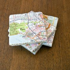 Give Old Maps New Life as Tile Coasters: The next time you return from a fun adventure, commemorate your travels and create unique coasters using maps of the destination.