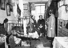 Home visit: a Salvation Army officer visits a couple in Notting Hill, west London, c1900
