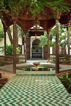 Gazebo with a fountain in the gardens of Bahia Palace (Bahia means brilliant), Marakesh, Morocco. It is a complex of ornately decorated reception rooms, apartments and gardens that was built by a grand vizier at the end of the 19th century. Take some time to admire the architecture mosaic ceilings, tiled courtyards and carved wooden columns.