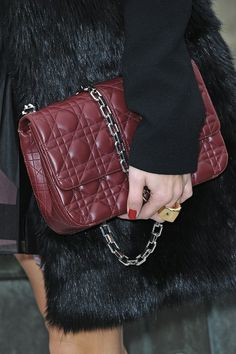16692822cee1 Olivia Palermo Chain Strap Bag - Olivia Palermo carried this maroon quilted  bag with a heavy chain strap to the Christian Dior show in Paris.