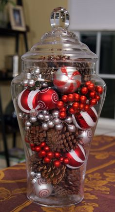 DIY Christmas Centerpieces - Easy Jar Holiday Centerpiece - Simple, Easy Holiday Decorating Ideas on A Budget - Cheap Home and Table Decor for The Holidays - Dollar Store Crafts, Rustic Candles, Pine Cones, Floral Ideas and Mason Jar Craft Projects http://diyjoy.com/diy-christmas-centerpieces