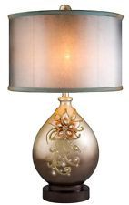 Take Your Home Decor A Notch Higher With This Table Lamp With Amazing Shade And Designs.This Sophisticated Table Lamp Is Finished In Glittery Champagne Gold amp Brown With A Floral Motif. Cement Table, Gold Candle Holders, Contemporary Table Lamps, Lamp Sets, Fabric Shades, Drum Shade, Vases Decor, Lighting, Home Decor