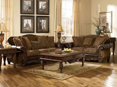 """Loveseat - 72""""W x 39""""D x 42""""H. KENDALL - OLD WORLD WOOD TRIM FABRIC SOFA SET. Mauricio Leather Sofa Set. Sofa - 95""""W x 39""""D x 42""""H. Ottoman - 31""""W x 24""""D x 18""""H. The plush rolled arms and front panel are covered in rich bonded leather that beautifully complements the traditional styled upholstery on the seat cushions and back. 