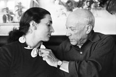 David Douglas Duncan (American, b. 1916) Untitled [Picasso adjusts a necklace he made for Jacqueline], c. 1957