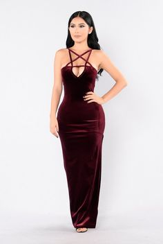 - Available in Burgundy and Black - Velvet - Strap Detail - Side Slit - Maxi Length - Made In USA - 90% Polyester 10% Spandex